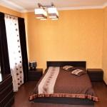 спальня в апартаментах отеля на море